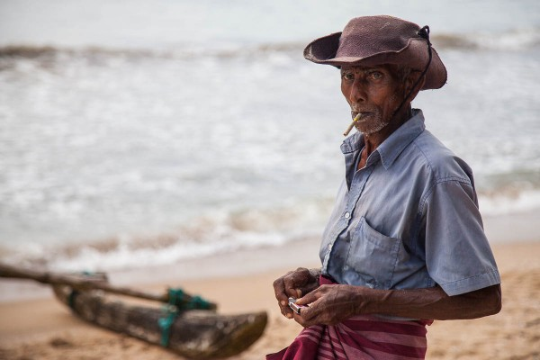 A fisherman at the beach in Galle, Sri Lanka.