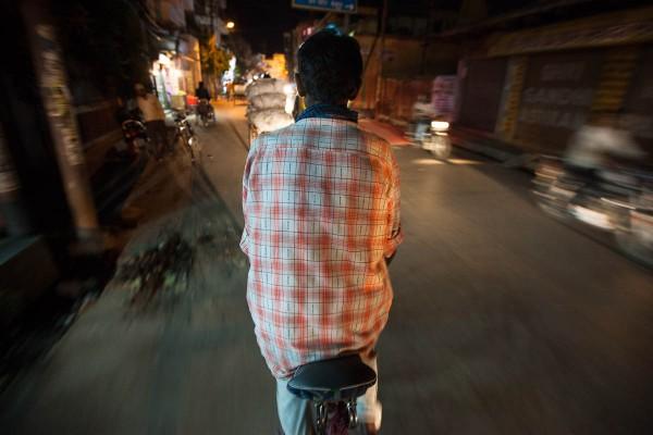 Man driving a rickshaw on the streets of Varanasi, India.