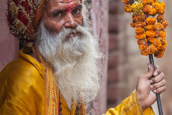A holy man or sadhus sitting by the street in Varanasi, India
