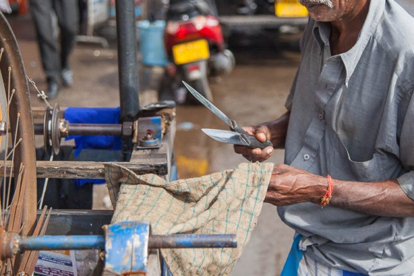 A portrait of a man fixing knives at Sri Lanka.