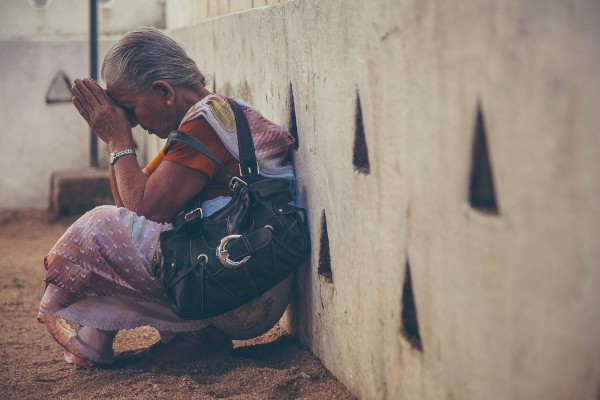 A woman praying at a temple in Sri Lanka.