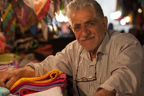 A seller at the bazaar in Kashan, Iran.