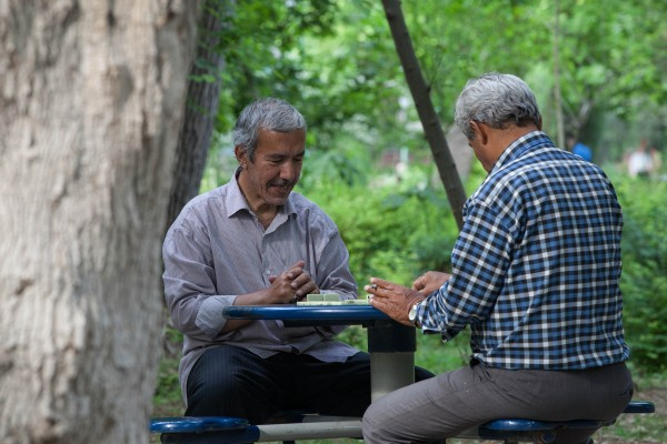 Two man playing chess at a park in Tehran, Iran