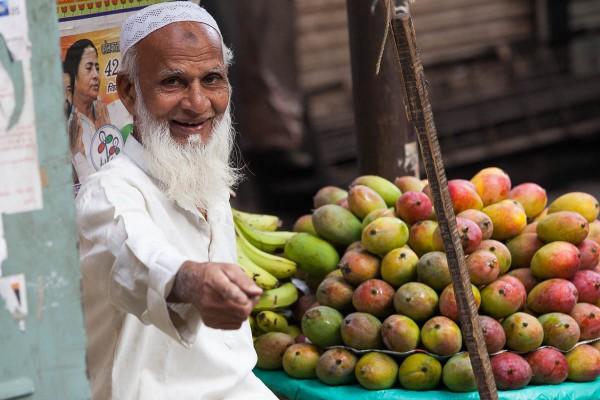 A man selling fruit at the Food market in Kolkata, India