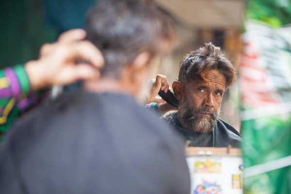 A man at the hairdresser in Kolkata, India