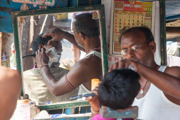 A man having a shave at the streets of Kolkata, India