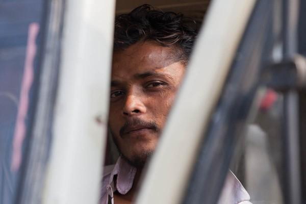 A man waiting in the car at the streets of Kolkata, India