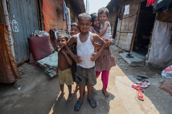 Children posing in one of the slums in Kolkata, India.