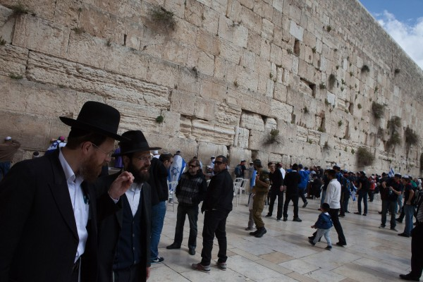 Two jewish man talking in front of the Western Wall in Jerusalem, Israel