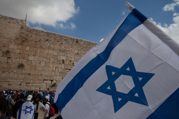 Israeli flag in front of the Western Wall in Jerusalem, Israel
