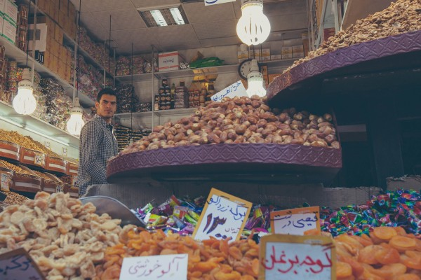 A seller of dried fruit at the Grand Bazaar in Tehran, Iran