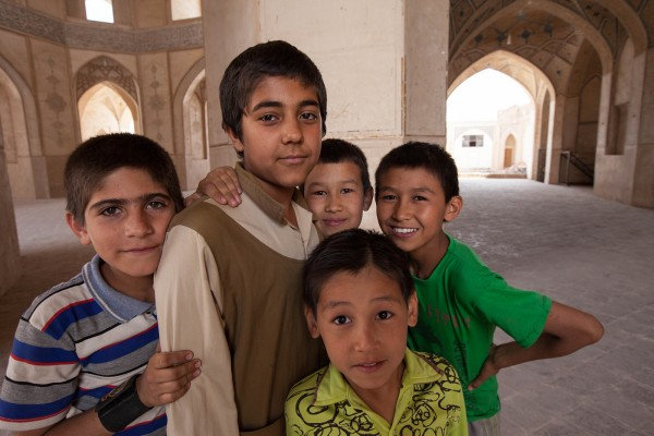 A group of kids posing for a photo in Yazd, Iran