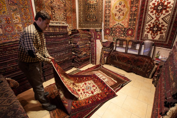 A carpet seller at the Grand Bazaar in Tehran, Iran