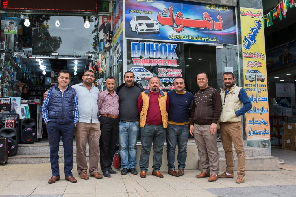 Group of guys posing in front of their shop in Duhuk / Dohuk, Iraqi Kurdistan