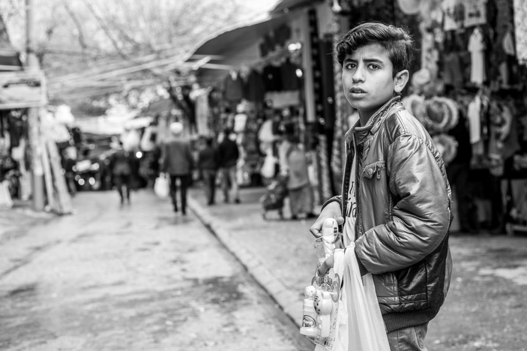A boy selling sweets at the Bazaar in Sulaymaniyah, Iraqi Kurdistan