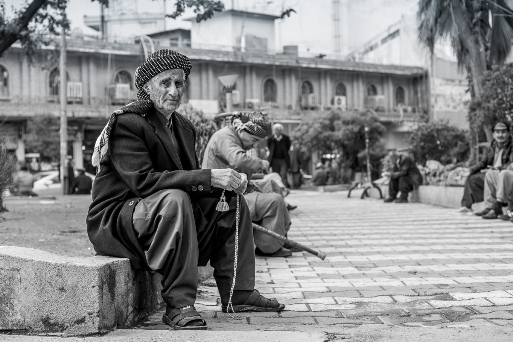 An old man sitting by the street in Sulaymaniyah, Iraq