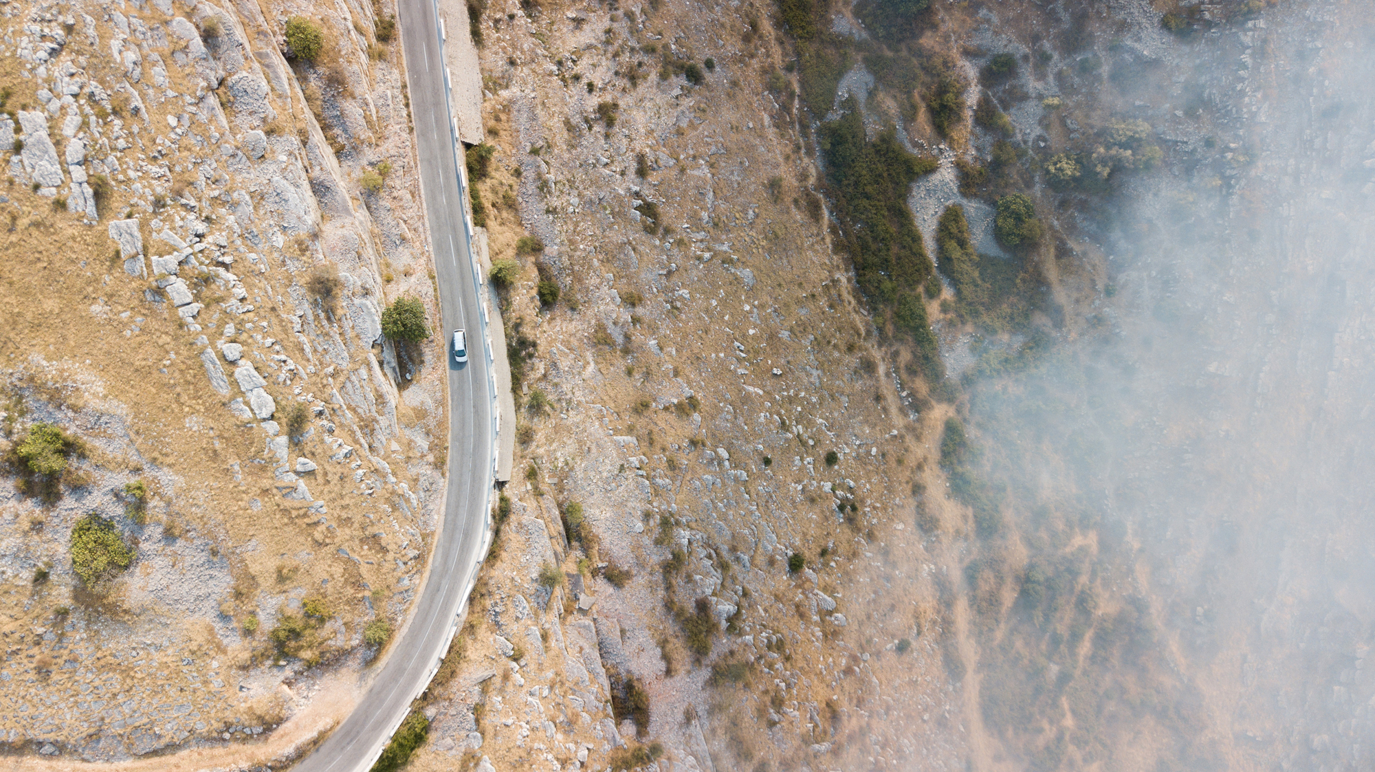 An aerial photo of a road in Albania