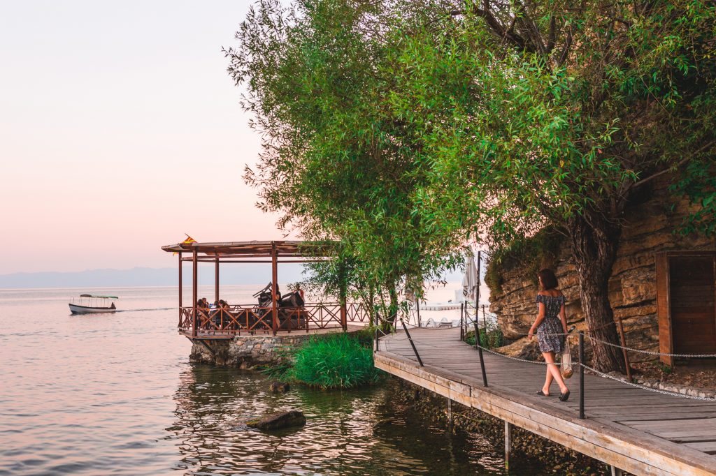 A girl walking down the pier at Lake Ohrid, Macedonia