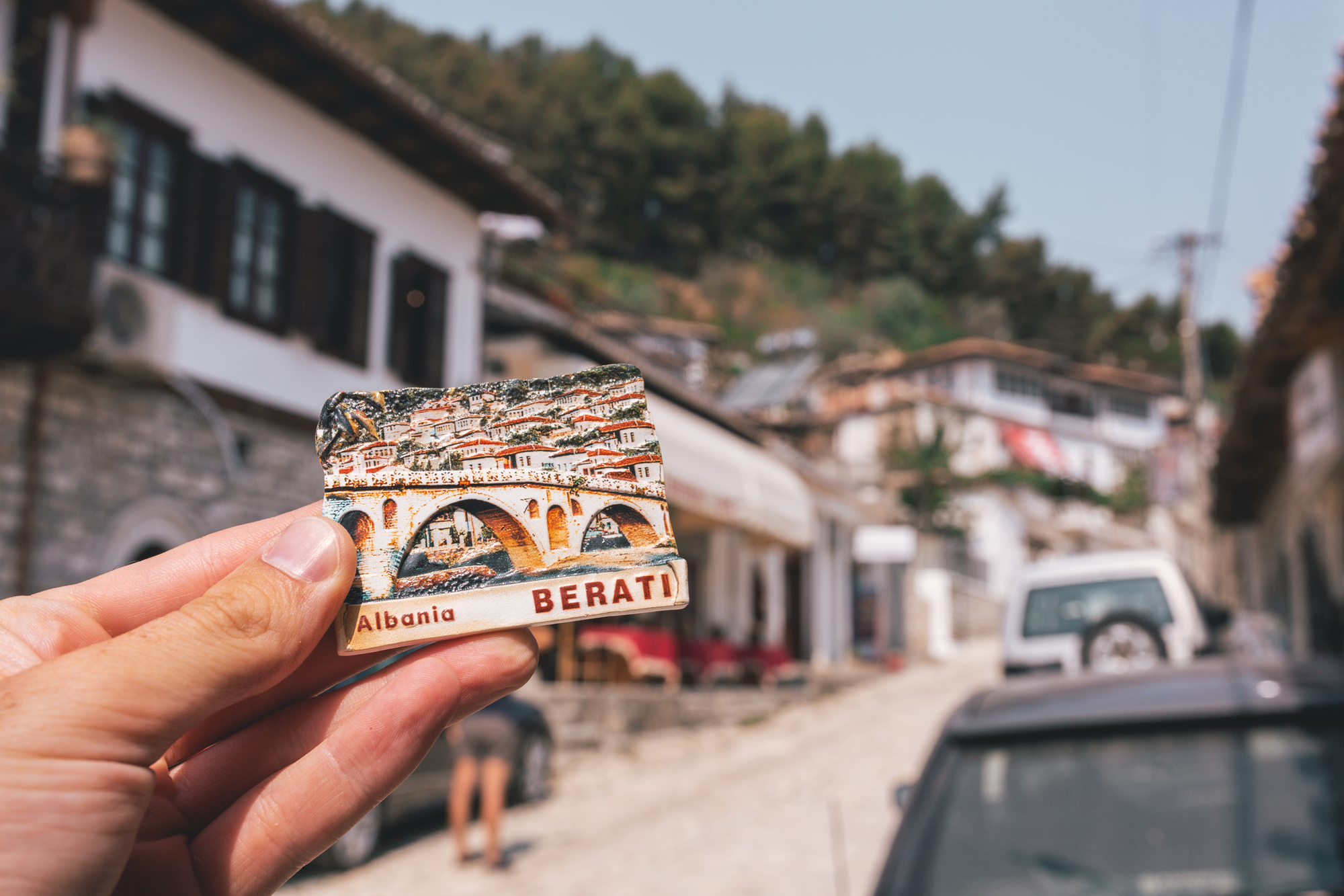 A girl holding a souvenir in Berati, Albania.