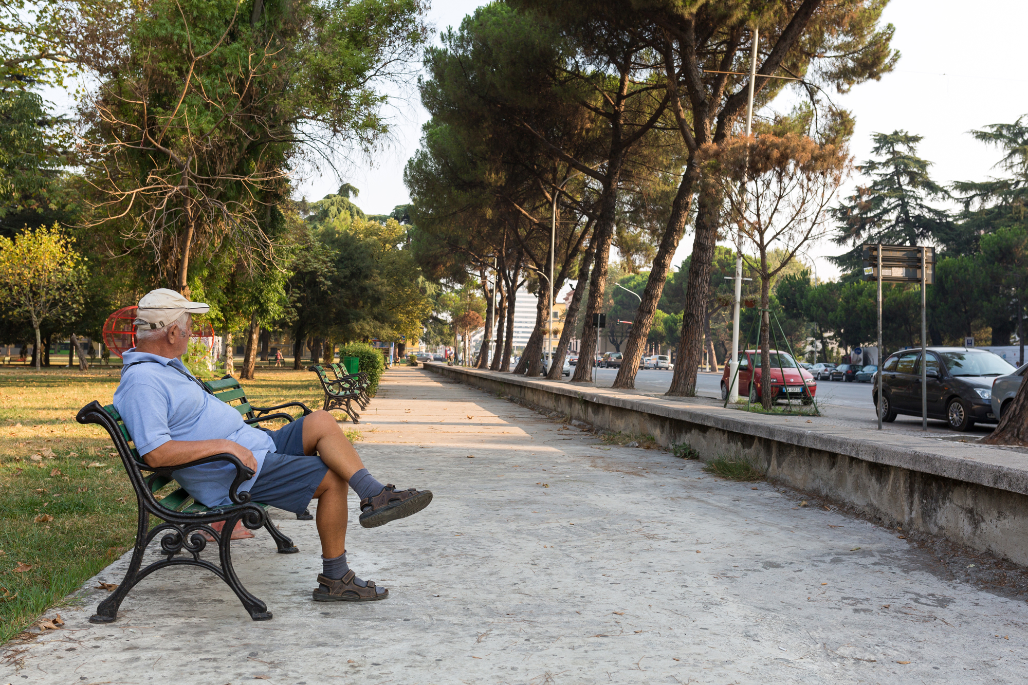 A man sitting on a bench in Tirana, Albania.