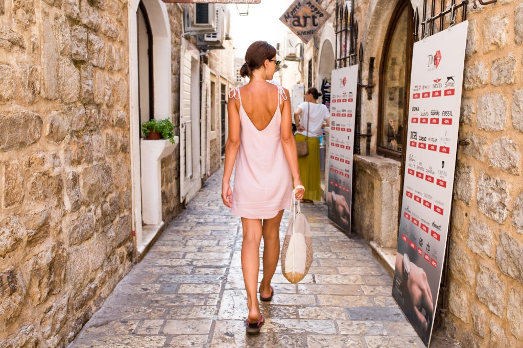 Girl walking down the streets of Dubrovnik, Croatia