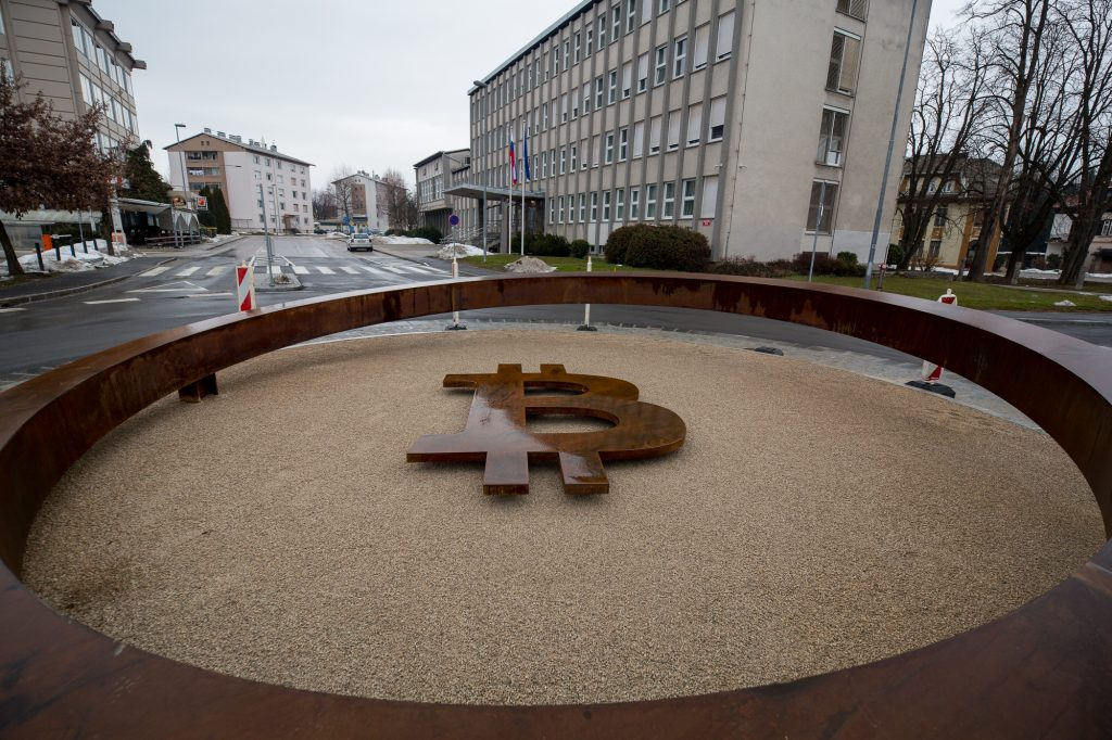 Bitcoin sign / statue at the roundabout in Kranj (Slovenia, Europe).