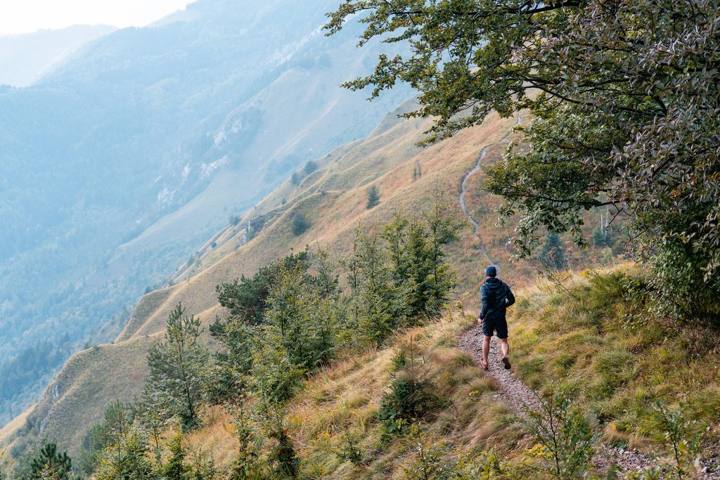 Kamniski vrh, Slovenia - September 2018: A man (photographer) running down from Kamniski vrh