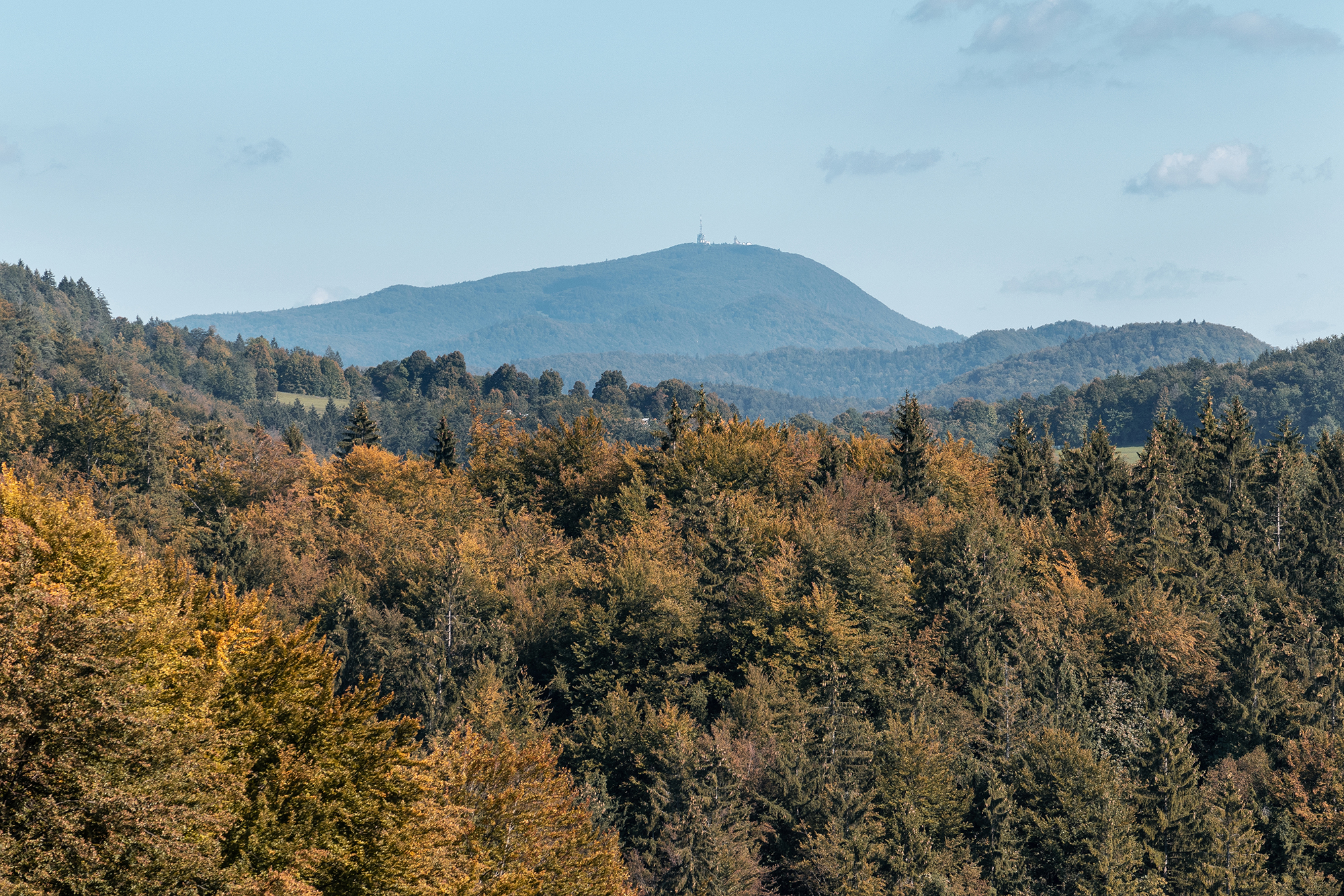 September 29, 2018 - Zasavska Sveta gora: Photo from a hike from Vace to Zasavska Sveta gora in Slovenia - view on mountain Kum with autumn forest in front.