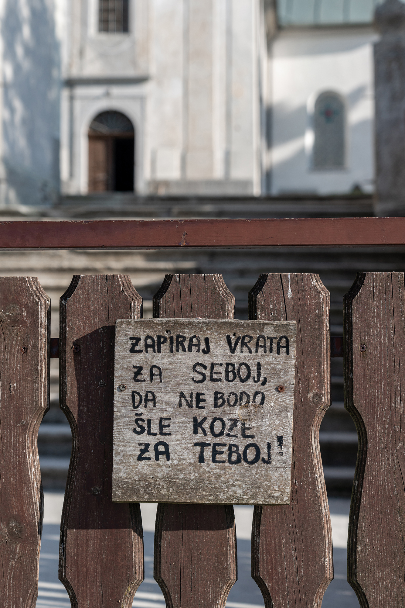 September 29, 2018 - Zasavska Sveta gora: Photo from a hike from Vace to Zasavska Sveta gora in Slovenia - a sign on the door before entering the graveyard.