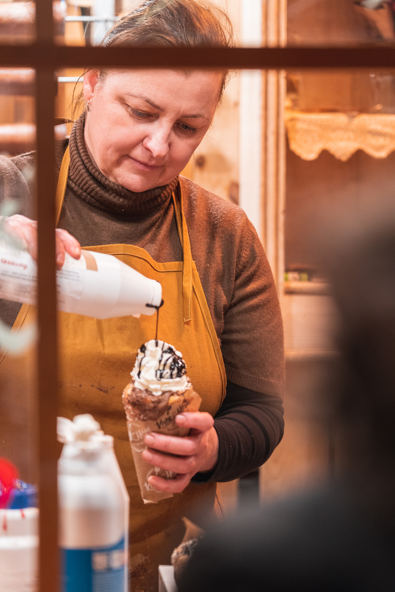 A vendor preparing a Christmas pastery at the Christmas market i