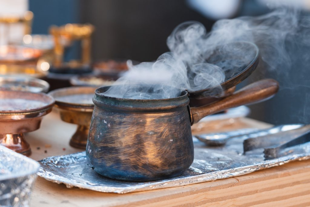 Incense container with smoke coming out at the Christmas market