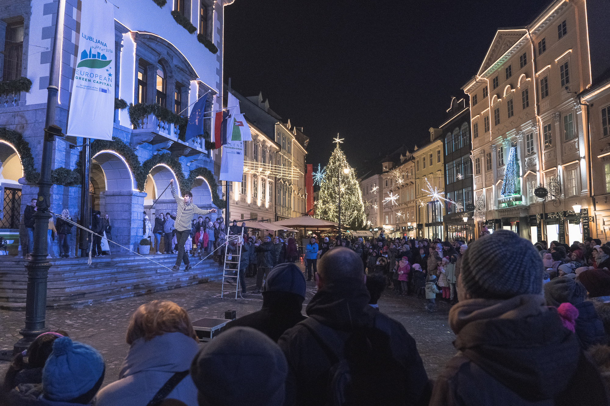 A street performer in front of Ljubljana City Hall at Christmas time