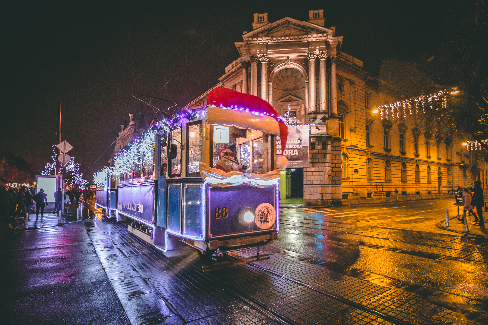 Public tram decorated with Christmas lights and Santa Claus behind the wheel in Zagreb, Croatia