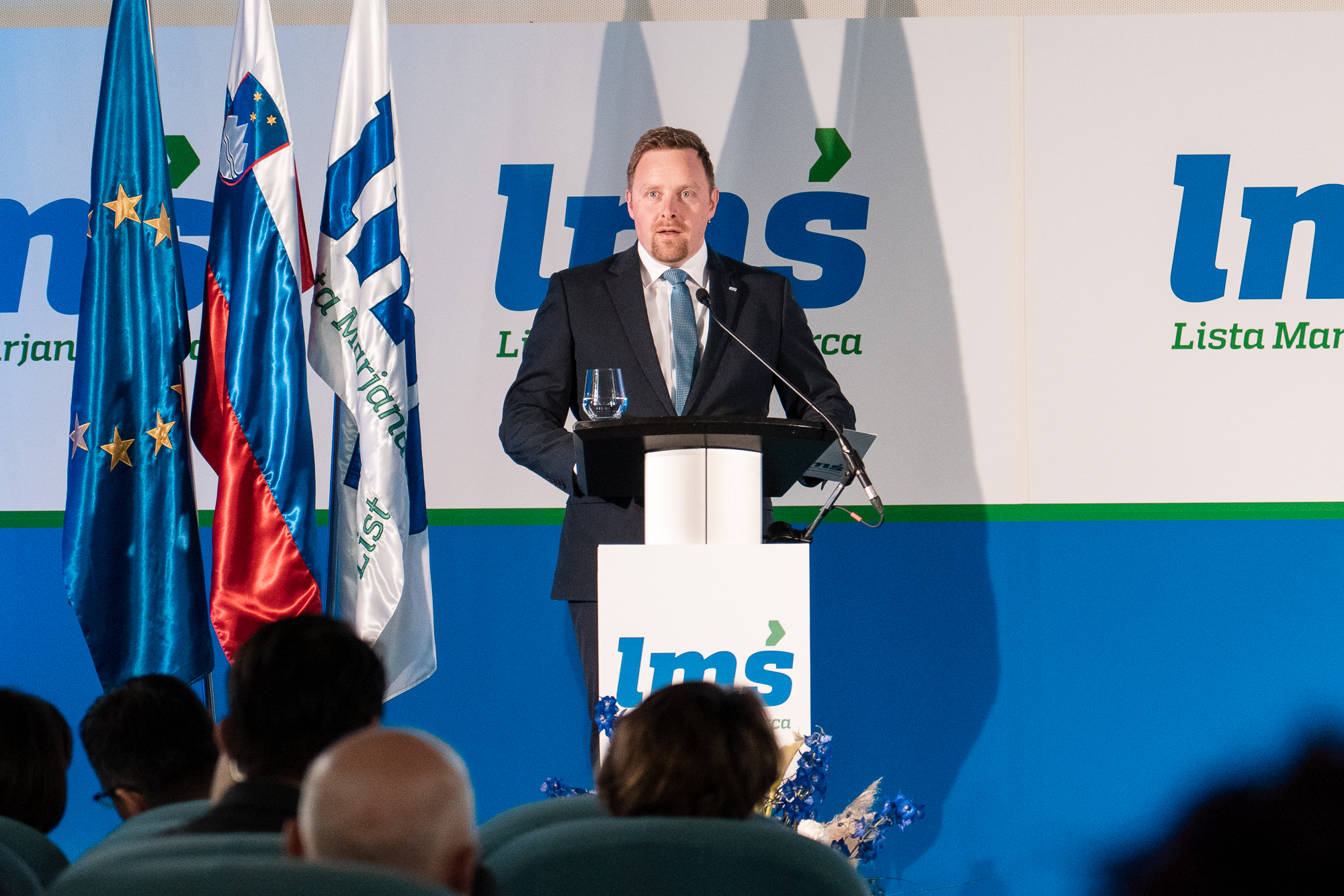 Igor Žavbi, vice president of Lista Marjana Šarca, on the stage at the Fifth Congress of LMŠ